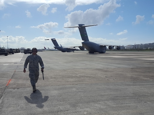 Master Sgt. Alan Romero, an airfield manager for the 167th Airlift Wing, provides support to airfield operations at the Luis Munoz Marin International Airport in San Juan, Puerto Rico. Romero deployed to San Juan shortly after Hurricane Maria devastated the island last month.