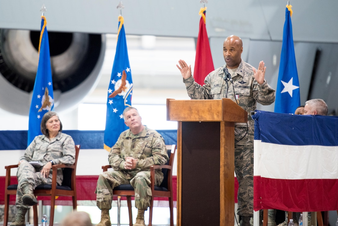 """Brig. Gen. Christopher """"Mookie"""" Walker, Chief of Staff for the West Virginia Air National Guard, makes remarks during his promotion ceremony held at the 167th Airlift Wing, Martinsburg W.Va., Oct. 14. Seated behind him are Brig. Gen. Paige Hunter, the Assistant Adjutant General for Air of the West Virginia National Guard and Maj. Gen. James Hoyer, the Adjutant General for the West Virginia National Guard. (U.S. Air National Guard photo by Staff Sgt. Jodie Witmer)"""