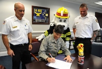 Col. Debra Lovette, 81st Training Wing commander, signs the Fire Prevention Week Declaration at the 81st TRW headquarters building Oct. 10, 2017, on Keesler Air Force Base, Mississippi. The week-long event includes fire drills, literature handouts, stove fire demonstrations around the base and concludes with an open house at the fire department Oct. 14. (U.S. Air Force photo by Kemberly Groue)