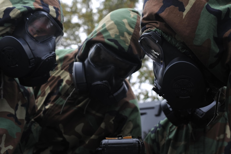 Airmen inspect M8 paper during Chemical, Biological, Radiological, Nuclear and high-yield Explosives training Oct. 10, 2017, at little Rock Air Force Base, Ark. The course consists of individual knowledge-based and demonstration performance objectives that provide an in-depth education on CBRNE defense hazards and protective actions. (U.S. Air Force photo by Airman 1st Class Grace Nichols)