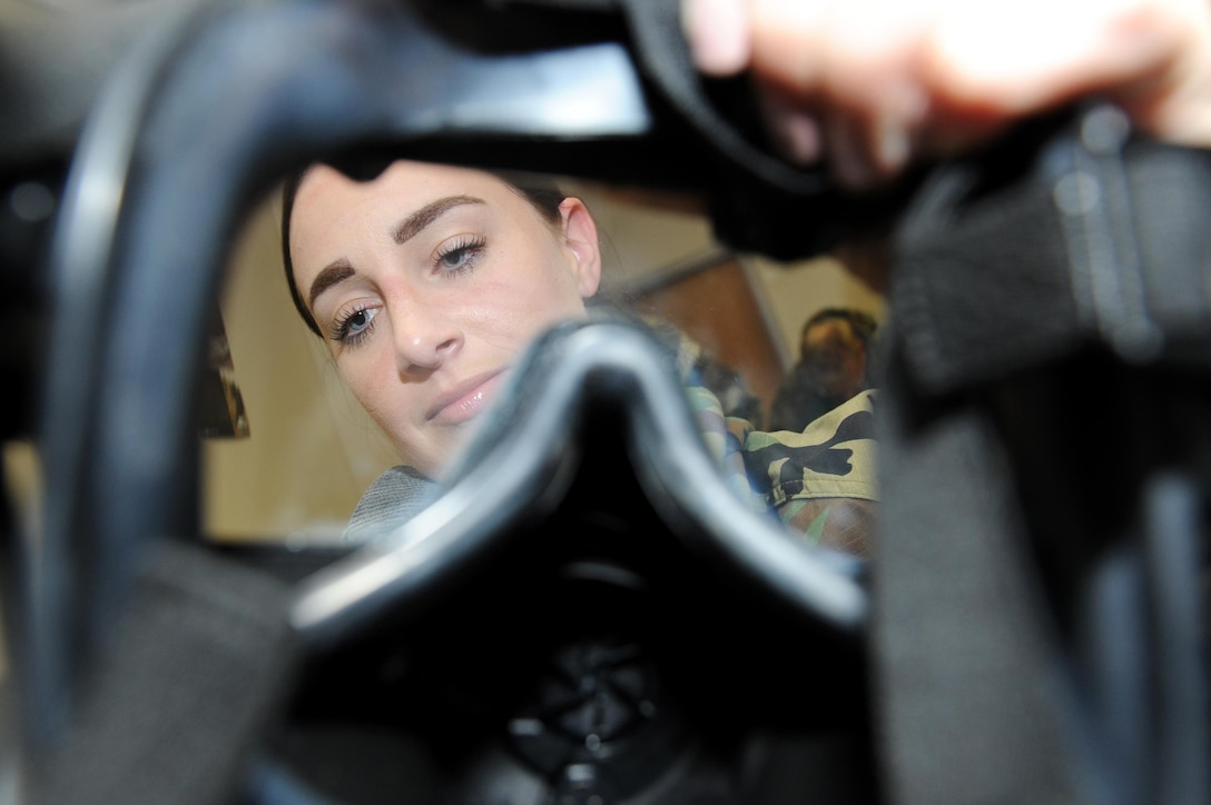 Tech. Sgt. Amber Montanaro, 19th Medical Group Tricare operations and patient administration NCO in charge, inspects a gas mask for defects during a Chemical, Biological, Radiological, Nuclear and high-yield Explosives training course Oct. 10, 2017, at little Rock Air Force Base, Ark.  A gas mask inspection should be performed every six months when not in a combat zone or every seven days while in a combat zone. (U.S. Air Force photo by Airman 1st Class Grace Nichols)
