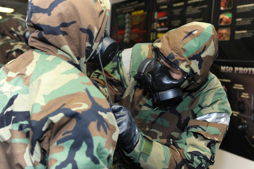Staff Sgt. Joshua Edanz, 41st Airlift Squadron loadmaster, checks a wingman's protective equipment during Chemical, Biological, Radiological, Nuclear and high-yield Explosives training Oct. 10, 2017, at little Rock Air Force Base, Ark. Buddy checks are designed to ensure Airmen have properly assembled their mission-oriented protective posture gear. (U.S. Air Force photo by Airman 1st Class Grace Nichols)