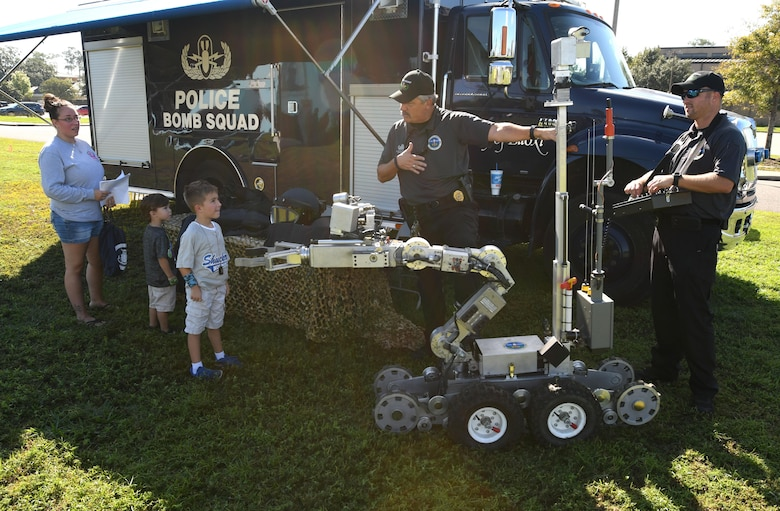 Lt. Milton Houseman, Biloxi Police Department Bomb Squad commander, talks about the capabilities of an F6A andros police robot to Keesler families during Operation Hero Oct. 14, 2017, on Keesler Air Force Base, Mississippi. The event was designed to help children better understand what their parents do when they deploy. (U.S. Air Force photo by Kemberly Groue)