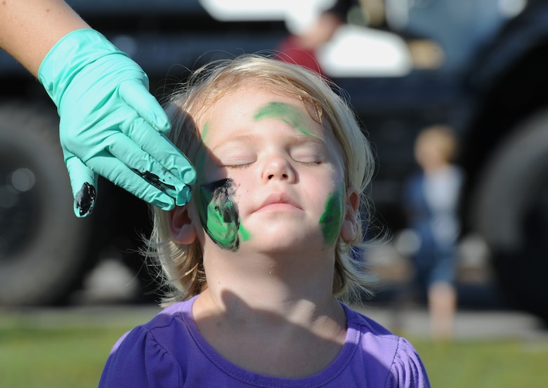Corinne Graham, daughter of Tech. Sgt. Benjamin Graham, 334th Training Squadron instructor, has her face painted during Operation Hero Oct. 14, 2017, on Keesler Air Force Base, Mississippi. The event was designed to help children better understand what their parents do when they deploy. (U.S. Air Force photo by Kemberly Groue)