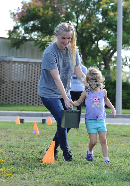 Nicole and Paisley Hoose, complete  the Keesler Marine Detachment obstacle course during Operation Hero Oct. 14, 2017, on Keesler Air Force Base, Mississippi. The event was designed to help children better understand what their parents do when they deploy. (U.S. Air Force photo by Kemberly Groue)