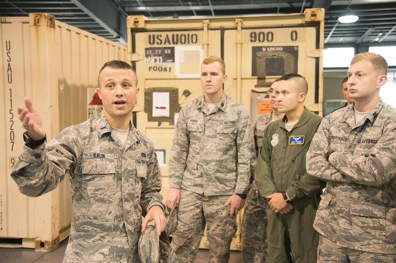 1st Lt. Hunter Kalin, 436th Aerial Port Squadron Air Terminal Operations Center flight commander, gives ROTC cadets a tour of the Super Port Oct. 11, 2017, at Dover Air Force Base, Del. Cadets from several colleges visited the base to get a closer look at the various occupational specialties offered by the Air Force. (U.S. Air Force photo by Mauricio Campino)