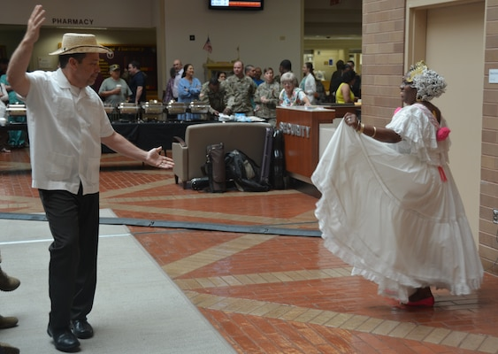 Lee Perez and Alcira Etienne dance a traditional Spanish dance Oct. 5 at the Hispanic Heritage observance in the Brooke Army Medical Center Medical Mall.