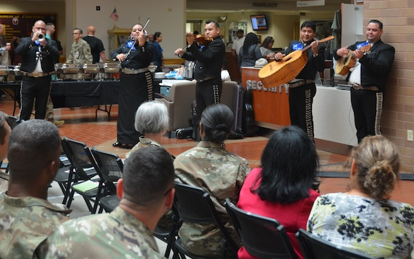 Mariachi Mexico De Noche entertains the crowd Oct. 5 at the Hispanic Heritage observance in the Brooke Army Medical Center Medical Mall.