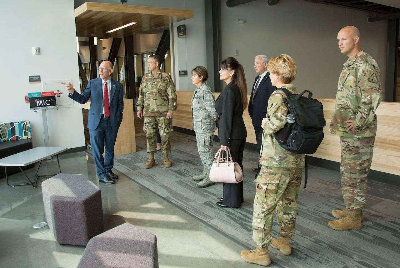 Charles Ambrose, left, president of the University of Central Missouri, leads a tour of the university's new Missouri Innovation Campus for members and employees of the Missouri National Guard.