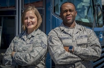 U.S. Air Force Staff Sgt. Christine Robinson, a unit deployment manager, and Staff Sgt. Kevin Robinson, a vehicle dispatcher, both assigned to the 6th Logistics Readiness Squadron, pause for a photo at MacDill Air Force Base, Fla., Oct. 12, 2017. The married couple has completed four deployments between the two of them, totaling 28 months, and are now scheduled to serve their first deployment together. (U.S. Air Force photo by Senior Airman Mariette Adams)