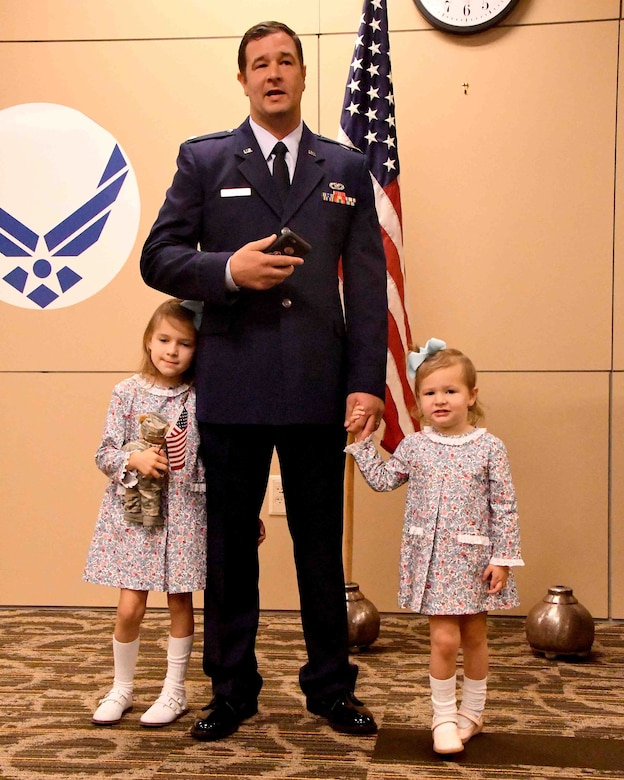 Maj. Joseph Thomas, 94th Civil Engineer Squadron commander, addresses the audience during an assumption of command ceremony at Dobbins Air Reserve Base, Georgia on Oct. 15, 2017. After officially assuming command of the squadron, his daughters Caroline and Marjorie Thomas joined him while he addressed the crowd. (U.S. Air Force photo by Staff Sgt. Jaimi L. Upthegrove)