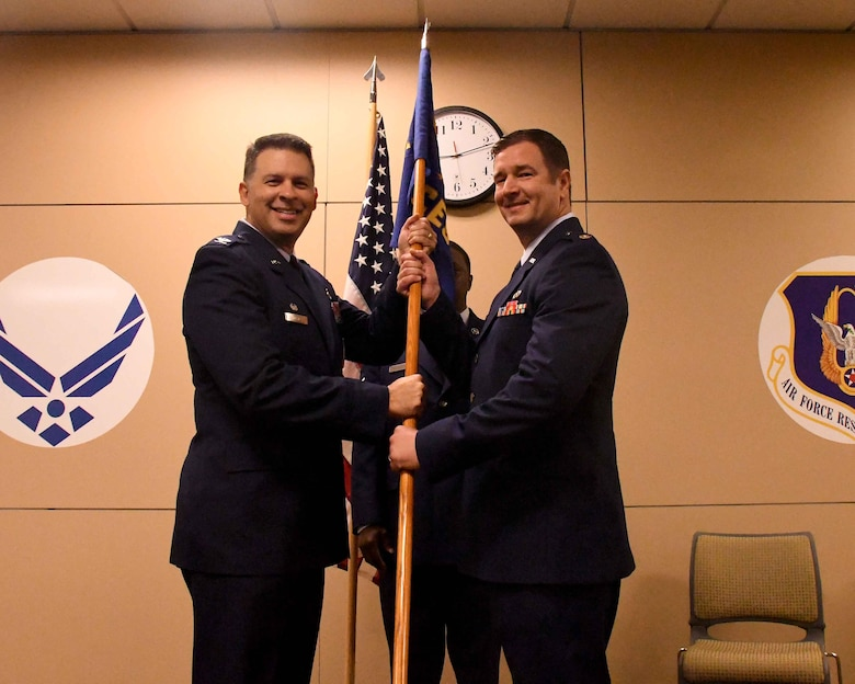 Maj. Joseph Thomas, right, assumes command of the 94th Civil Engineer Squadron from Col. Marty Hughes, 94th Mission Support Group commander, during a ceremony at Dobbins Air Reserve Base, Georgia on Oct. 15, 2017. Thomas said he hopes earn the new title in the eyes of the Airmen he is charged to lead every day. (U.S. Air Force photo by Staff Sgt. Jaimi L. Upthegrove)
