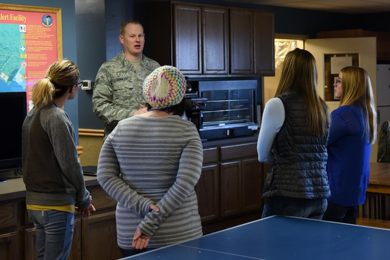 Staff Sgt. Thomas Stanley, 12th Missile Squadron facility manager, speaks with spouses during a tour at a missile alert facility Oct. 14, 2017, at Malmstrom Air Force Base, Mont. Stanley showed the spouses what day-to-day operations are at a MAF. (U.S. Air Force photo/Tech. Sgt. Caleb Pierce)
