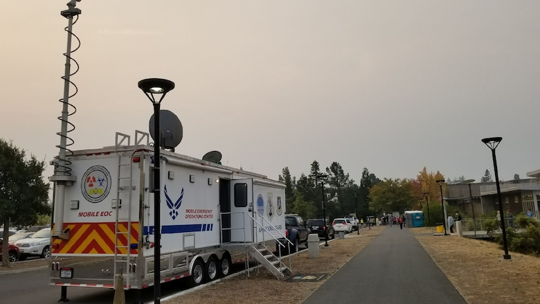 A Mobile Emergency Operations Center (MEOC) from the California Air National Guard's 163d Attack Wing at March Air Reserve Base, is set up at Napa Valley College in Napa, California, to provide communications support to victims of the Northern California fires Oct. 11, 2017.