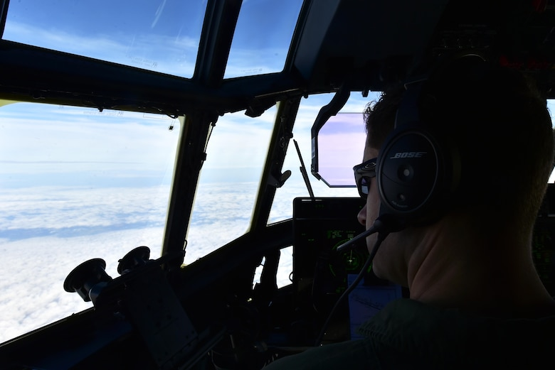 U.S. Air Force Capt.Christopher Freed, 37th Airlift Squadron pilot, stares out the cockpit of a C-130J Super Hercules while flying from Ramstein Air Base, Germany, to Powidz AB, Poland, Oct. 13, 2017. Airmen assigned to the 86th Airlift Wing flew to Poland for the latest iteration of Operation Atlantic Resolve, a NATO-led training operation between the U.S. Air Force and Polish Air Force. (U.S. Air Force photo by Staff Sgt. Jonathan Bass)
