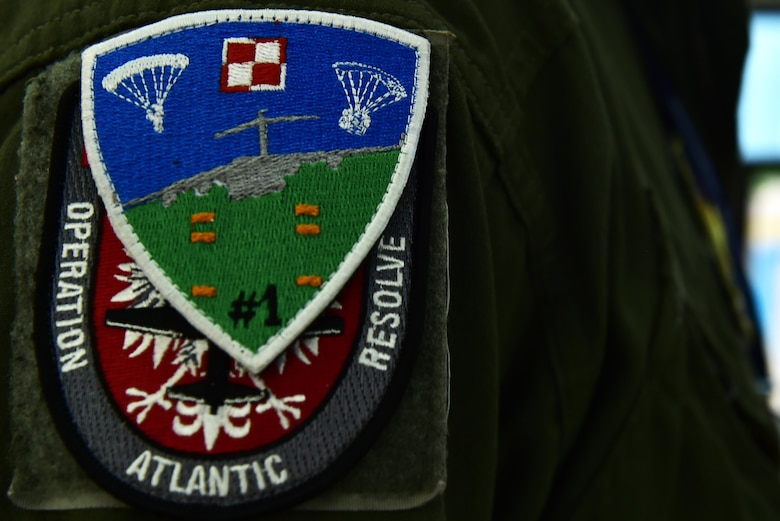 U.S. Air Force Capt. Jonathan Hansen, 37th Airlift Squadron pilot and Operation Atlantic Resolve mission commander, wears a Polish Air Force patch over his OAR patch on Powidz Air Base, Poland, Oct. 16, 2017. The mission of OAR is to enhance interoperability while simultaneously maintaining regional security with the Polish Air Force. (U.S. Air Force photo by Staff Sgt. Jonathan Bass)