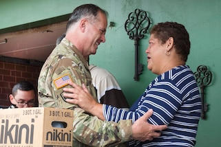 Soldiers and National Guard members deliver cases of water and shelf-stable meals to residents in Jayuya, Puerto Rico, Oct. 11, 2017. Air Force photos