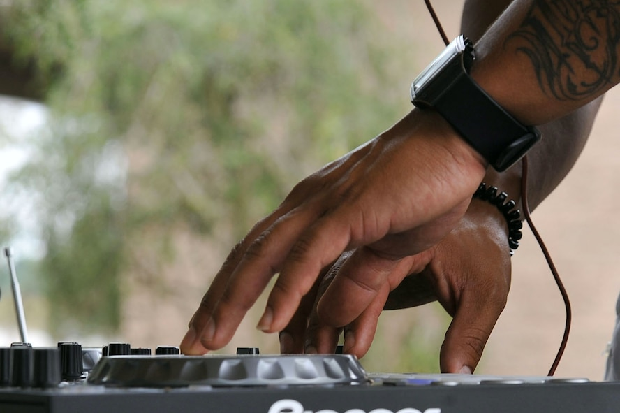 U.S. Air Force Staff Sgt. Israel Ortiz, 20th Civil Engineer Squadron structural supervisor and Hispanic Organization for Latin Appreciation member, acts as a disc jockey during a Hispanic Heritage Month finale at Shaw Air Force Base, S.C., Oct. 12, 2017.