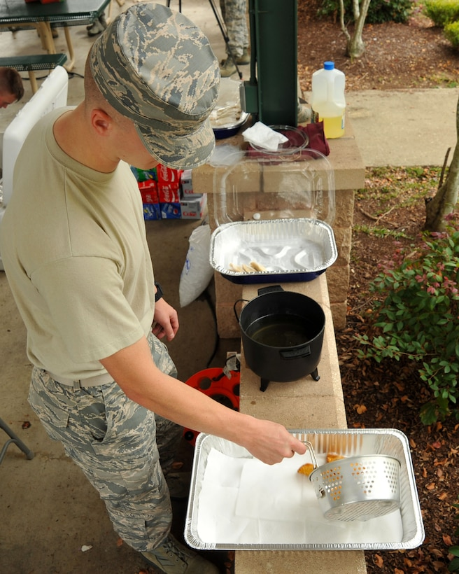 U.S. Air Force Airman Adam O'Donnell, U.S. Air Forces Central Command cyber systems apprentice and event volunteer, prepares empanadas during a Hispanic Heritage Month finale at Shaw Air Force Base, S.C., Oct. 12, 2017.