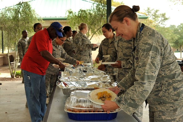 Team Shaw members gather for a potluck lunch of Hispanic foods during a Hispanic Organization for Latin Appreciation hosted finale event for Hispanic Heritage Month at Shaw Air Force Base, S.C., Oct. 12, 2017.