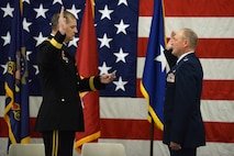 Maj. Gen. Al Dohrmann (left), North Dakota adjutant general, administers the commissioning oath to newly-promoted Brig. Gen. Todd Branden Oct. 7, 2017, during a promotion ceremony held at the North Dakota Air National Guard Base in Fargo, North Dakota. Branden, who now will serve as the North Dakota National Guard assistant adjutant general, Air, is the organization's newest general officer.