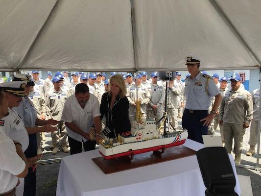 A man cuts a cake.