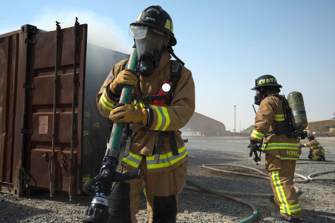 A fire fighter from the 386th Expeditionary Civil Engineer Squadron Fire Department exit's a live fire training facility at an undisclosed location in Southwest Asia, Oct. 20, 2017. The training was a coordinated effort with various units on base to ensure Airmen's safety was upheld and mission capability was not interrupted. (Air Force photo by Staff Sgt. William Banton)
