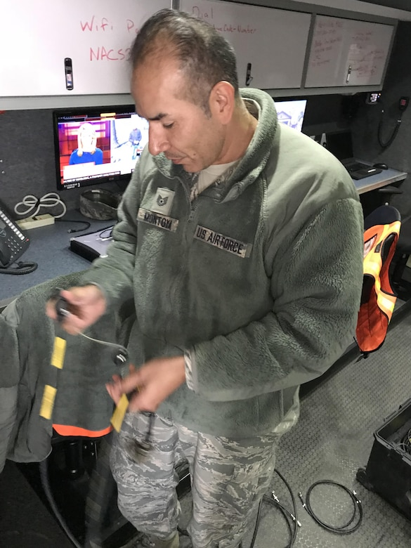 California Air National Guard Tech. Sgt. Javier Montoya sets up a flyaway kit Oct. 11, 2017, to provide satellite internet service inside a Mobile Emergency Operations Center (MEOC) from the 163d Attack Wing at March Air Reserve Base, to evacuees at Napa Valley College in Napa, California. The MEOC provided wireless internet access and a cell phone network for victims of the Northern California fires who took up shelter in the college gymnasium. (U.S. Air National Guard photo by Staff Sgt. Tyler Crumpton)