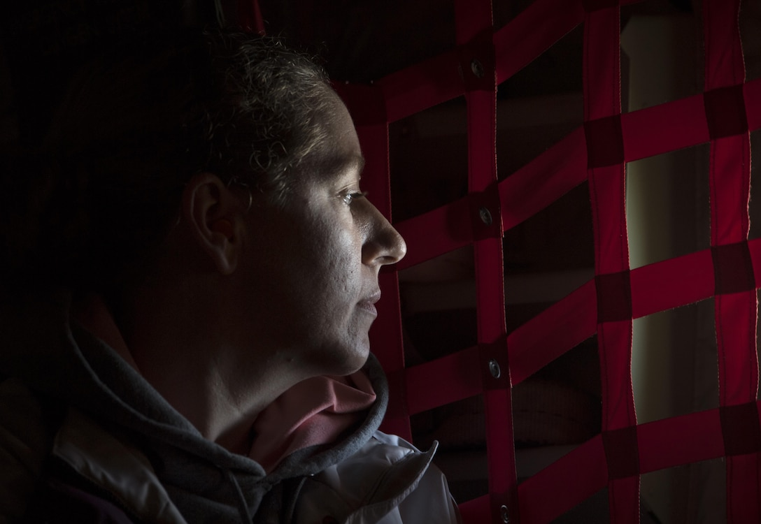 Dyann Wenckus, spouse of 86th Airlift Wing Vice Commander Col. Joseph H. Wenckus, looks out the window of a C-130J Super Hercules flying near Ramstein Air Base, Germany, Oct. 17, 2017. Wenckus and other military spouses flew on the C-130 as an incentive flight as part of the Ramstein Airman and Family Readiness Center's Heart Link program, which provides information and networking opportunities for military spouses. (U.S. Air Force photo by Senior Airman Tryphena Mayhugh)