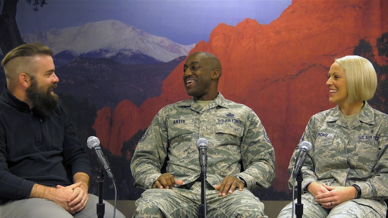 Steve Kotecki (left) 21st Space Wing Public Affairs Office, public affairs specialist, interviews Senior Master Sgt. Raymond Artis, 721st Mission Support Group superintendent of plans and programs (center), and Master Sgt. Ashely Strong, 21st Medical Squadron dental flight chief, at Peterson Air Force Base, Colorado, Oct. 10, 2017. Artis and Strong were both named one of the twelve Outstanding Airman of the Year for 2017. (U.S. Air Force photo by David Meade)