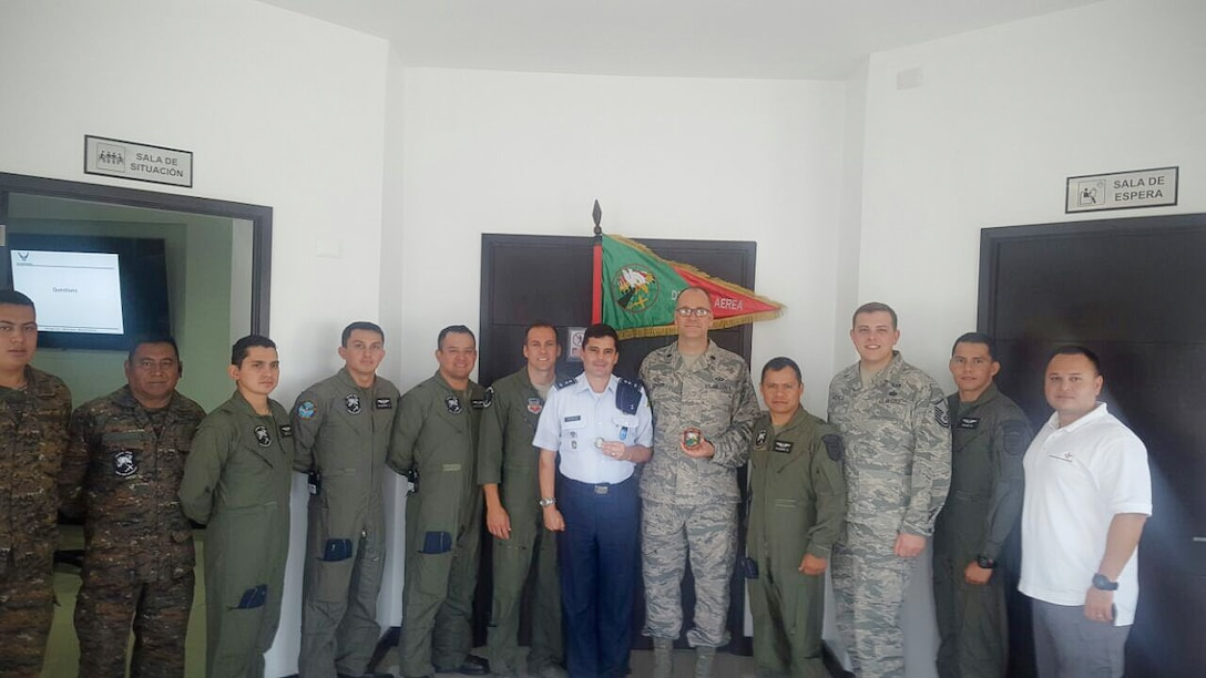 The 225th Air Defense Squadron members exchange unit coins with the Guatemalan Air Force during their State Partnership Program visit to Guatemala Aug. 25, 2017.  The SPP links a state's National Guard with the armed forces of a partner country in a cooperative, mutually beneficial relationship by means of tailored, small footprint, high-impact security cooperation engagements that foster long-term enduring relationships with U.S. friends and allies around the world.  The SPP arose from a 1991 U.S. European Command decision to pair reserve component soldiers and airmen with the armed forces of the then newly formed nations of the Baltic Region following the collapse of the Soviet Bloc.