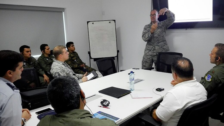 Lt. Col. Eric Corder, assistant director of operations for the 225th Air Defense Squadron, discusses air defense intercept concepts with the Guatemalan Air Force as part of the State Partnership Program Aug. 25, 2017.  The SPP links a state's National Guard with the armed forces of a partner country in a cooperative, mutually beneficial relationship by means of tailored, small footprint, high-impact security cooperation engagements that foster long-term enduring relationships with U.S. friends and allies around the world.  The SPP arose from a 1991 U.S. European Command decision to pair reserve component soldiers and airmen with the armed forces of the then newly formed nations of the Baltic Region following the collapse of the Soviet Bloc.