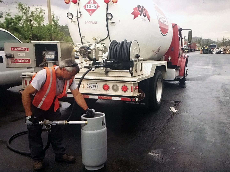 worker fills propane tank