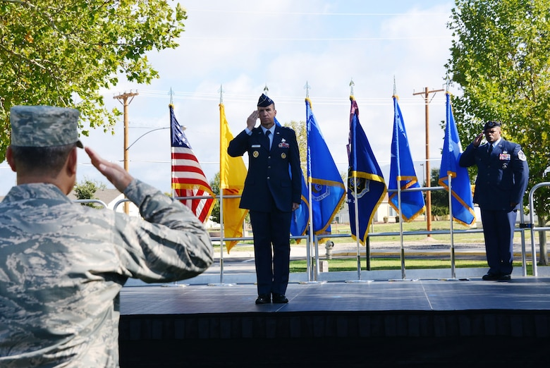 Maj. Gen. Shaun Q. Morris, Air Force Nuclear Weapons Center's new commander, issues his first salute at his change of command ceremony Oct. 6 at Hardin Field.