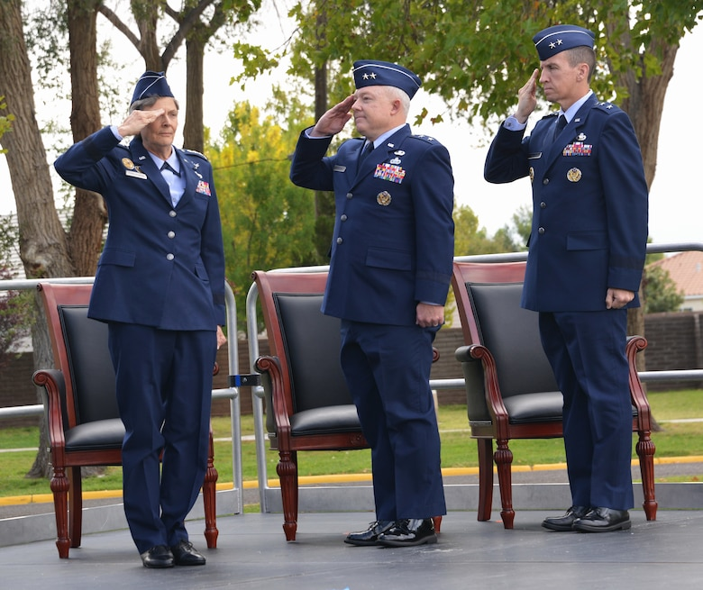 From left, Air Force Materiel Command Commander Gen. Ellen M. Pawlikowski, outgoing Air Force Nuclear Weapons Center Commander Maj. Gen. Scott Jansson and incoming AFNWC Commander Maj. Gen. Shaun Q. Morris salute during the change of command ceremony Friday at Hardin Field. Pawlikowski presided over the ceremony.