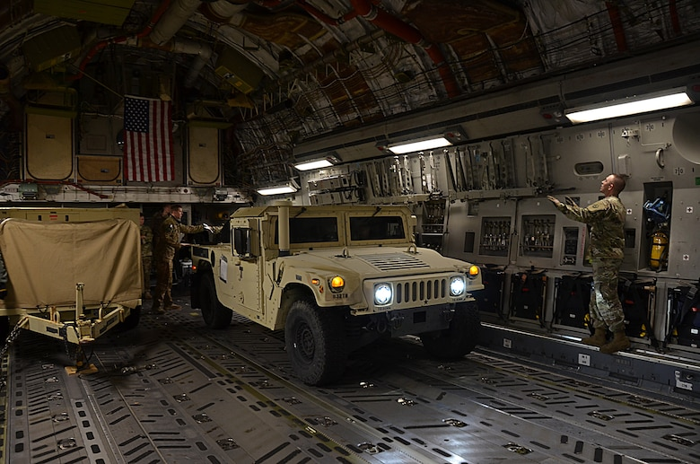 U.S. Army Soldiers from the 832nd Transportation Battalion, 597th Transportation Brigade, load vehicles and cargo onto a U.S. Air Force Air Mobility Command C-17 at Joint Base Langley-Eustis, Va., Oct. 18, 2017.