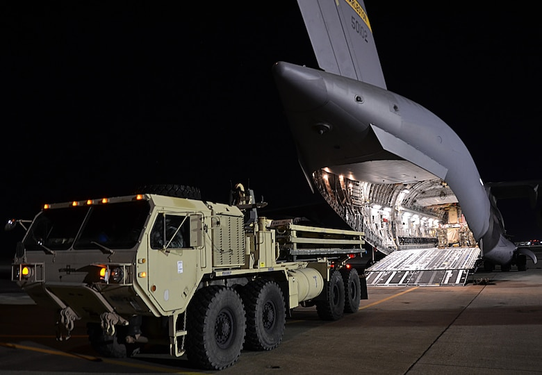 U.S. Army Soldiers from the 832nd Transportation Battalion, 597th Transportation Brigade, load a vehicle onto a U.S. Air Force Air Mobility Command C-17 at Joint Base Langley-Eustis, Va., Oct. 18, 2017.