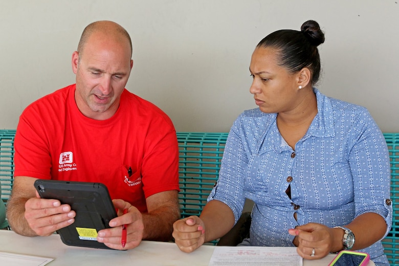 A quality insurance inspector for the U.S .Army Corps of Engineers assists during a right-of-entry registration.