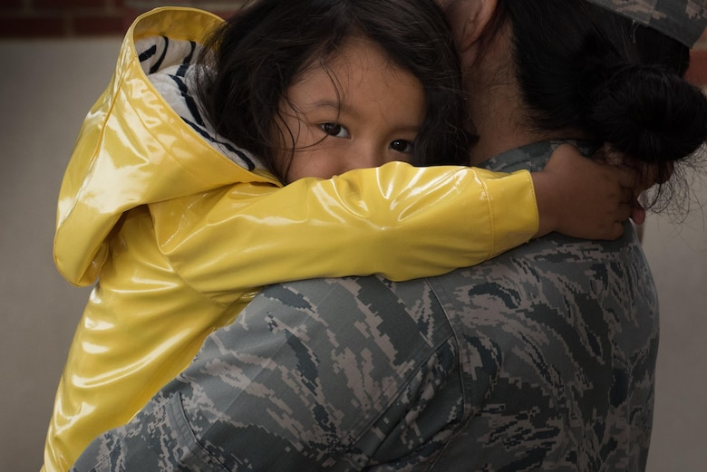 U.S. Air Force Maj. Becky Azama, 633rd Medical Operations Squadron physical medicine flight commander, embraces her daughter, Remi, before deploying from Joint Base Langley-Eustis, Va., Oct. 18, 2017.