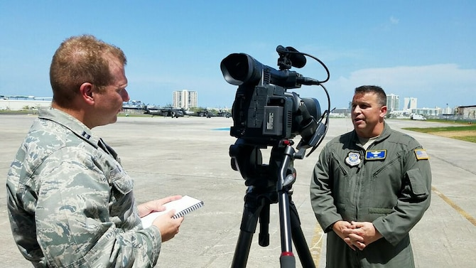 Capt. David J. Murphy, 81st Training Wing public affairs chief, interviews Maj. Gen. Thomas J. Sharpy, the joint forces land component deputy commander in charge of air operations and deputy commander for Air Mobility Command, in San Juan, Puerto Rico, Oct. 8, 2017.