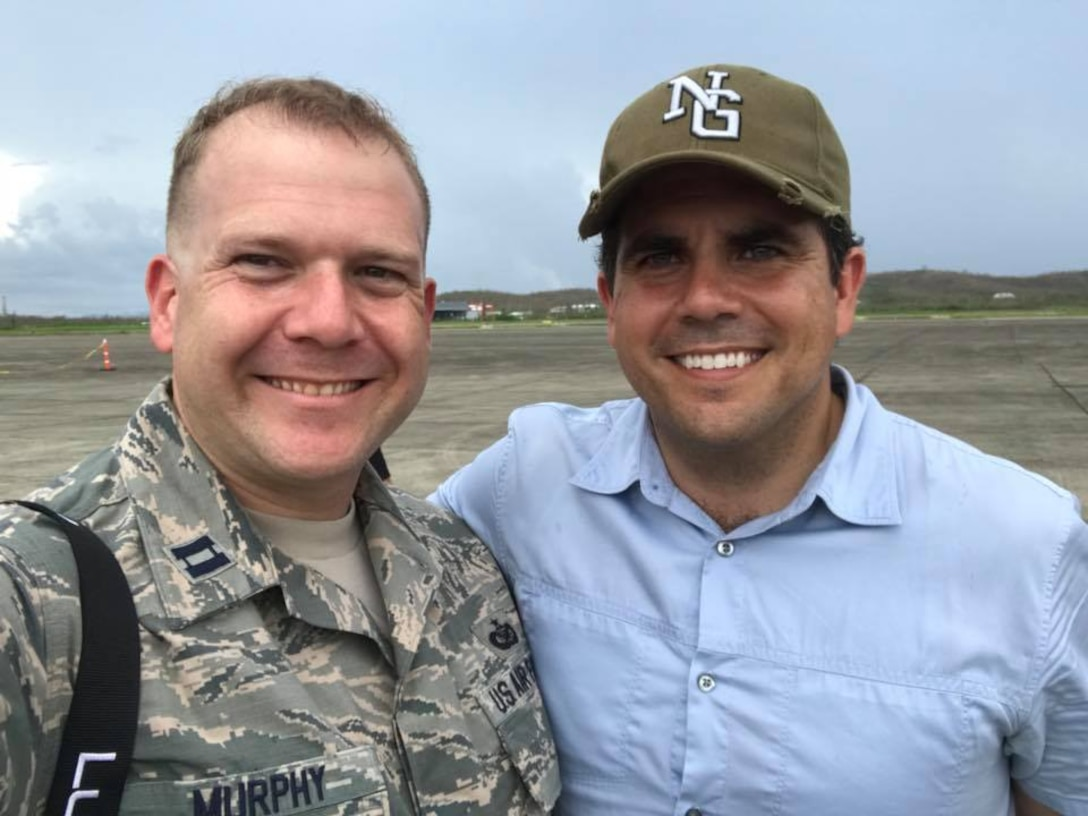 U.S. Air Force Capt. David J. Murphy poses for a photo with the governor of Puerto Rico, Ricardo Rosselló, at Jose Aponte de la Torre Airport in Ceiba, Puerto Rico, Oct. 11, 2017.