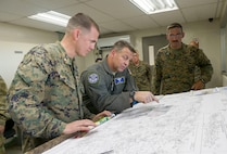 U.S Marine Corps Maj. Gregory Scott (left), 26th Marine Expeditionary Unit operations officer, briefs U.S. Air Force Maj. Gen. Timothy Sharpy, Joint Forces Land Component Commander deputy commander in charge of air operations, about operations in and around Mercedita Airport in Ponce, Puerto Rico, Oct. 8, 2017.