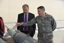 Col. Britt Hatley, the 119th Wing commander, right, points out a few features on an inert, training bomb for Fargo, N.D., Mayor Tim Mahoney during a base familiarization tour and mission briefing for the mayor at the North Dakota Air National Guard Base in Fargo, Oct. 16, 2017.