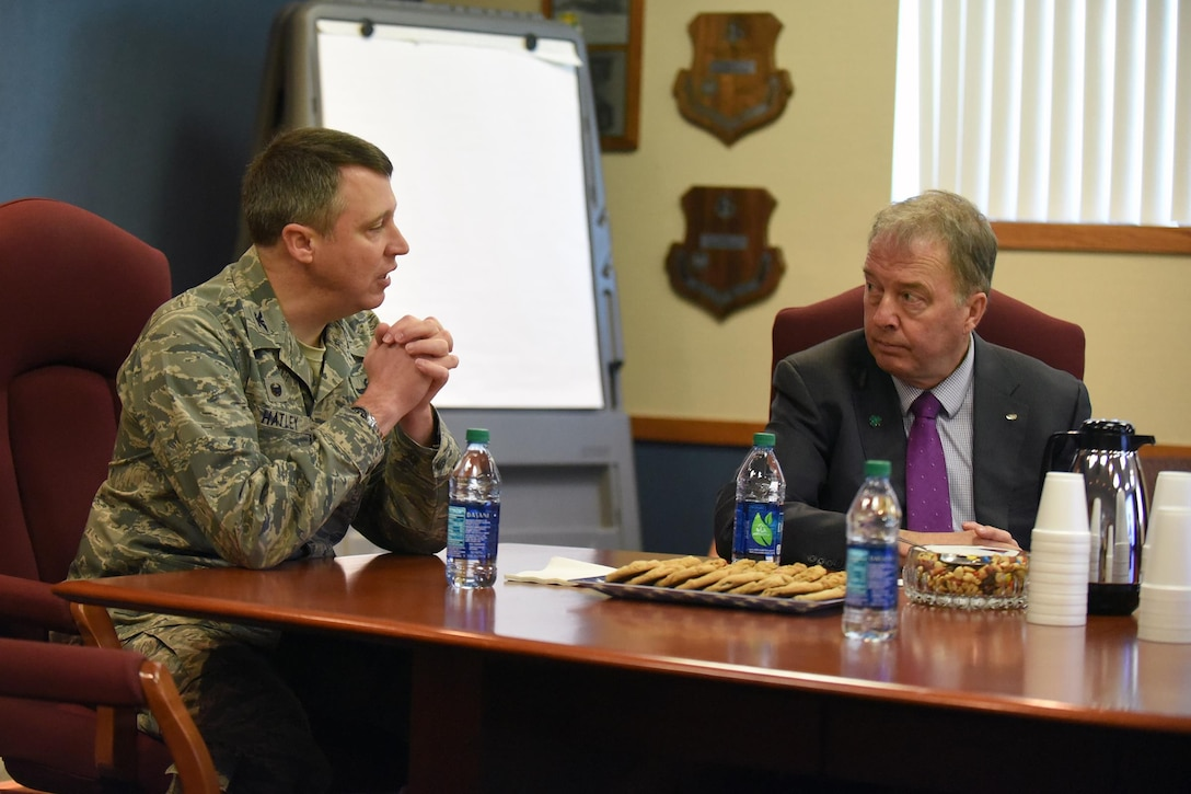 Col. Britt Hatley, the 119th Wing commander, left, visits with Fargo, N.D., Mayor Tim Mahoney during a base familiarization tour and mission briefing for the mayor at the North Dakota Air National Guard Base in Fargo, Oct. 16, 2017.