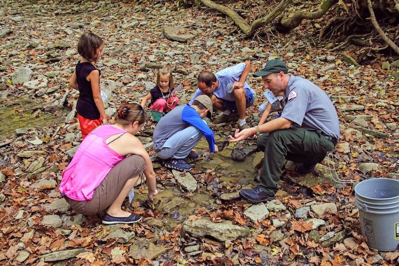 Ranger Mike Perrin and citizen scientists explore the macro-invertebrates found in the Sandy Run Creek below the dam at Caesar Creek Lake, Waynesville, Ohio.