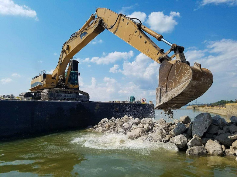 The Corps has built a rock dike, which will protect divers as they replace wickets in Dam 52.