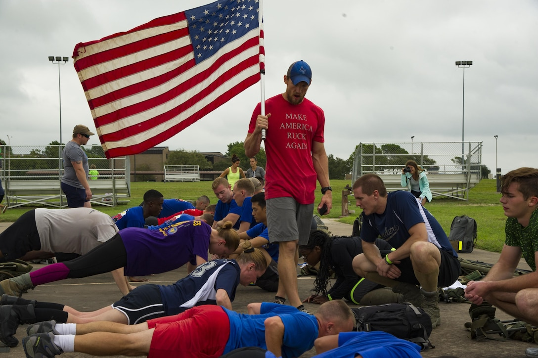 Participants in a ruck march challenge receive mentorship from their cadre while performing push-ups at Laughlin Air Force Base, Texas, Oct. 14, 2017.  The ruck was a 10-kilometer march which contained various challenges along the course. (U.S. Air Force photo\Airman 1st Class Daniel Hambor)