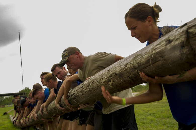 Participants in a ruck march challenge lift a log at Laughlin Air Force Base, Texas, Oct. 14, 2017.  The ruck, which challenged the 23-person team at various points during the 10 kilometer march, consisted of many team cohesion challenges. (U.S. Air Force photo\Airman 1st Class Daniel Hambor)