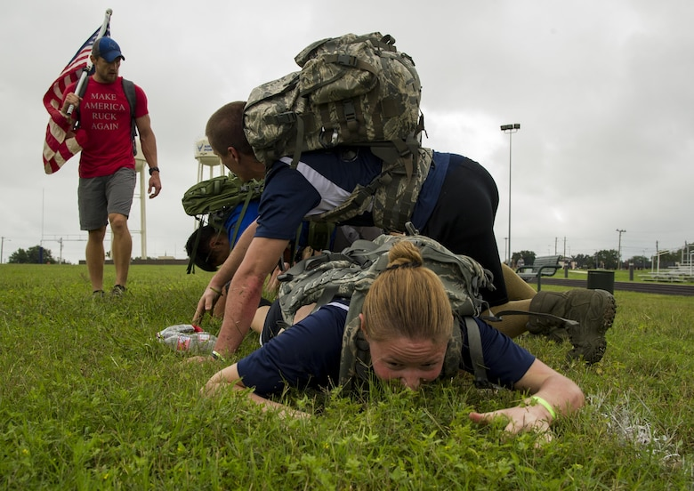 Participants in a ruck march challenge low crawl under their team at Laughlin Air Force Base, Texas, Oct. 14, 2017.  The march started when the 23-person group finished a series of team-building exercises consisting of low crawls, crowd surfing, and bear crawls.  (U.S. Air Force photo\Airman 1st Class Daniel Hambor)
