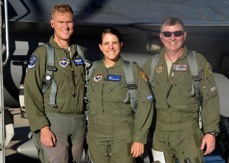 Maj. Alex Divine, 309th Fighter Squadron pilot, and Maj. Barbara Divine, 56th Contracting Squadron commander, take a photo with Col. Bryan Cook, 944th Fighter Wing commander, after their F-16 formation flight at Luke Air Force Base, Ariz., Oct. 12, 2017. Maj. Barbara Divine learned firsthand what her husband goes through in his training sorties and how her career in contracting impacts the mission. (U.S. Air Force photo by Senior Airman Devante Williams)